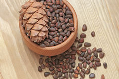 Wooden cup with nuts. Wooden cup with nuts on wooden background Royalty Free Stock Images