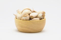 Wooden cup of rood garlic on white. Background Royalty Free Stock Photos
