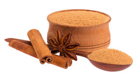 Wooden cup, spoon, star anise and cinnamon Stock Images