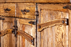 Wooden cupboard doors with forged metal handles Stock Image