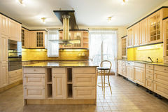Wooden cupboards in luxury kitchen Royalty Free Stock Images