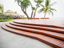 Wooden curve of step. Modern wooden curve of step decorating outdoor Royalty Free Stock Photos