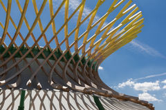 Wooden Curved Structure: Building with Modern Architectural Desi. Gn Royalty Free Stock Photos