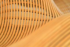 Wooden Curves. Many small square strips of oak wood fastened together and then bent into a free forming wave pattern royalty free stock photos