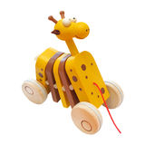 Wooden cute giraffe. Handmade clapping toy on wheels Royalty Free Stock Images