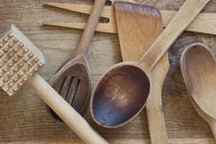 Wooden cutlery. Scattered on the board Stock Photos