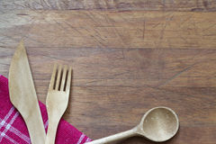 Wooden cutlery on cutting board abstract background Royalty Free Stock Photos