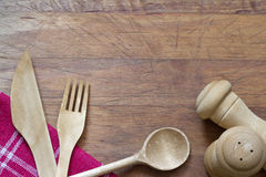 Wooden cutlery on cutting board abstract background Stock Images