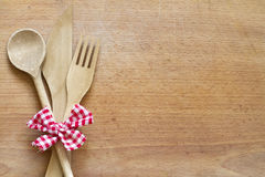 Wooden cutlery on cutting board abstract background Royalty Free Stock Image