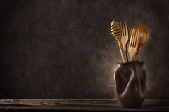 Wooden cutlery still-life. Wooden cutlery set on dark background stock images