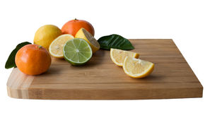 Wooden Cutting Board with Citrus Fruits. Royalty Free Stock Image