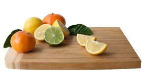 Wooden Cutting Board with Citrus Fruits. Stock Photography