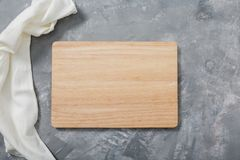 Wooden cutting board. For cooking food. Kitchen accessories. For your design. . Wooden cutting board. For cooking food. Kitchen accessories. For your design Royalty Free Stock Images