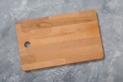 Wooden cutting board. For cooking food. Kitchen accessories. For your design. . Wooden cutting board. For cooking food. Kitchen accessories. For your design Stock Photography