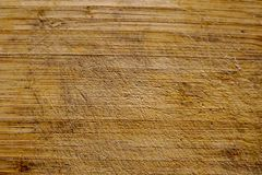 Wooden cutting board in cuts royalty free stock images