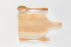 Wooden cutting board and fork Stock Photos