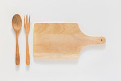 Wooden cutting board and fork Stock Images