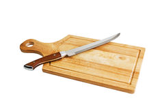 Wooden cutting board and knife Stock Images