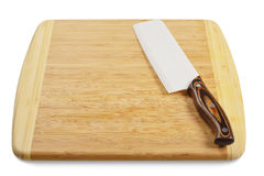 Wooden cutting board with knife Stock Images