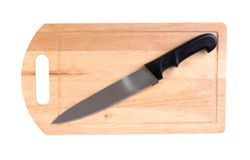 Wooden cutting board and knife Royalty Free Stock Images