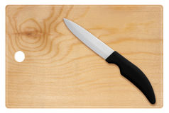 Wooden cutting board and knife Royalty Free Stock Photo