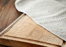 Wooden cutting board and linen napkin Royalty Free Stock Photos