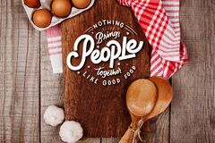 Free Wooden Cutting Board On A Wooden Background With Garlic, Ladles, Eggs And A Blank Notebook Royalty Free Stock Photography - 178608977