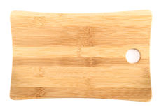 Wooden cutting board over white background. Wooden cutting board isolated over white background Royalty Free Stock Photo