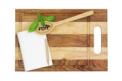 Wooden cutting board with pencil and a notebook Stock Images
