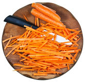 Wooden cutting board with raw strips sliced carrot Royalty Free Stock Photo