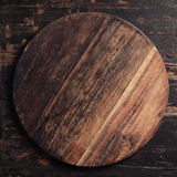 Wooden cutting board on rustic background Royalty Free Stock Image