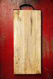 Wooden cutting board on rustic background Stock Image