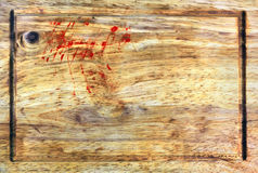 Wooden cutting board with traces of blood Royalty Free Stock Photography