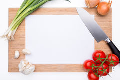 Wooden cutting board with vegetables Stock Image