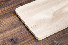 Wooden cutting board on wood table background. Wooden cutting board on wood table for background Royalty Free Stock Image