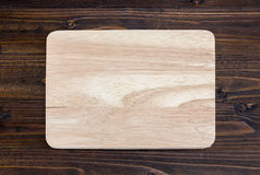 Wooden cutting board on wood table background. Wooden cutting board on wood table for background Stock Photography