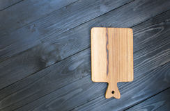 Wooden cutting boards on wooden blackground Royalty Free Stock Images