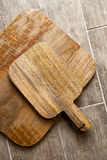 Wooden cutting boards on a wooden floor Royalty Free Stock Image