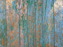 Wooden cyan and brown fence. Old cracked faded cyan fence of a village in Ukraine, a sign of poverty and abandonment Stock Photos