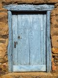 Wooden cyan window shutter in a traditional brickwork exterior wall. royalty free stock images