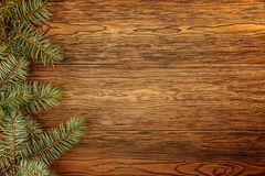 Wooden dark background for Your Christmas titles. Branches of blue spruce. The view from the top royalty free stock photos