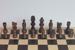 Wooden dark brown chess set monochromatic. Stock Photography