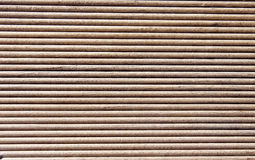 Wooden dark brown grooves panel Royalty Free Stock Photo