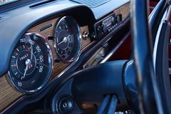Wooden dashboard in old car Royalty Free Stock Photos