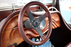 Wooden dashboard and steering wheel oldtimer Stock Photos
