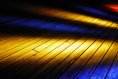 Wooden deck. Yellow and blue Illuminated on old wooden deck Royalty Free Stock Photos