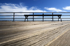 Wooden Deck with a Bench. Bench on a wooden deck on the beach of the Atlantic Ocean Royalty Free Stock Photo
