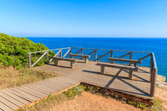 Wooden deck with benches for tourists Stock Photo