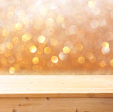 Wooden deck and bokeh light background for product display. Royalty Free Stock Images