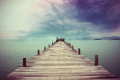 Wooden deck bridge to boat. Horizontal image of the wood bridge on sunset time in beautiful day in thailand Royalty Free Stock Photo
